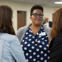 Ayana Weekley chats with two faculty members